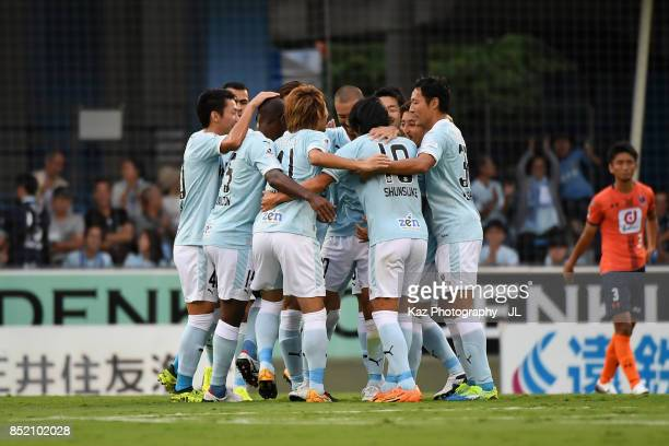 Shunsuke Nakamura of Jubilo Iwata celebrates scoring his side's first goal with his team mates during the JLeague J1 match between Jubilo Iwata and...