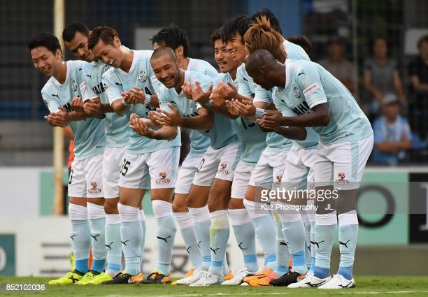 Shunsuke Nakamura of Jubilo Iwata celebrates scoring his side's first goal with his team mates during the JLeague J1 match between Jubilo Iwata and...
