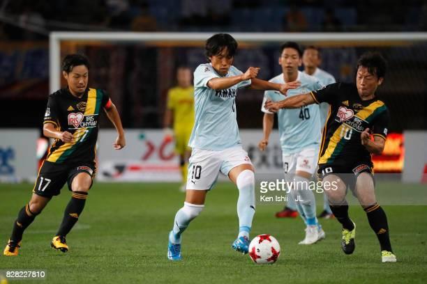 Shunsuke Nakamura of Jubilo Iwata competes for the ball against Shingo Tomita and Ryang Yong Gi of Vegalta Sendai during the JLeague J1 match between...