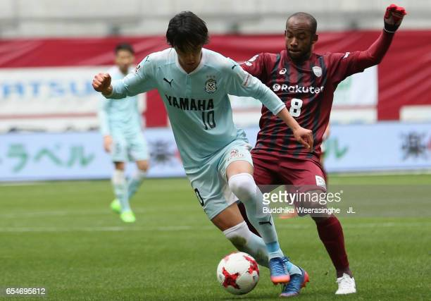 Shunsuke Nakamura of Jubilo Iwata controls the ball under pressure of Wescley of Vissel Kobe during the JLeague J1 match between Vissel Kobe and...