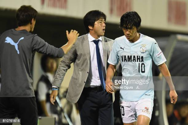 Shunsuke Nakamura of Jubilo Iwata is embraced by head coach Hiroshi Nanami after substituted during the JLeague J1 match between Jubilo Iwata and...