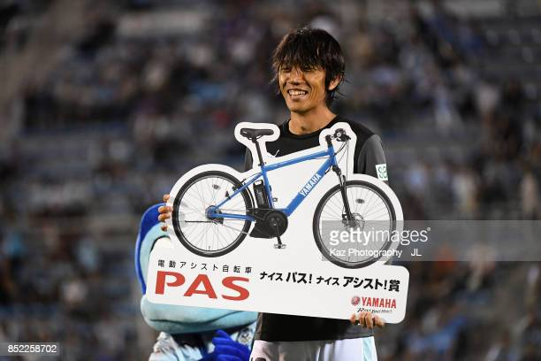 Shunsuke Nakamura of Jubilo Iwata poses for photographs during the ceremony after the JLeague J1 match between Jubilo Iwata and Omiya Ardija at...