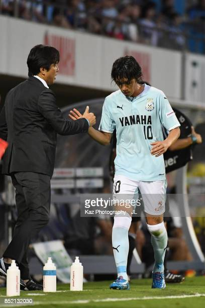 Shunsuke Nakamura of Jubilo Iwata shakes hand with Head coach Hiroshi Nanami after substituted during the JLeague J1 match between Jubilo Iwata and...