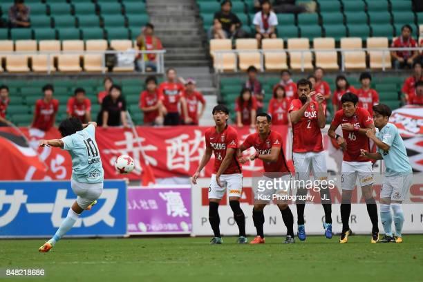 Shunsuke Nakamura of Jubilo Iwata takes a free kick during the JLeague J1 match between Jubilo Iwata and Urawa Red Diamonds at Shizuoka Stadium Ecopa...