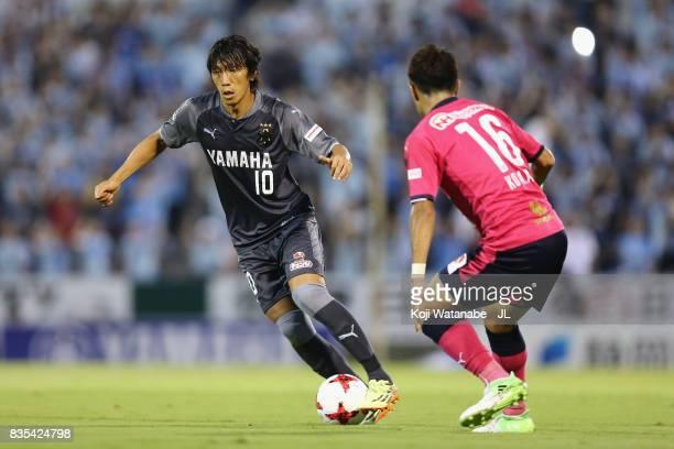 Shunsuke Nakamura of Jubilo Iwata takes on Kota Mizunuma of Cerezo Osaka during the JLeague J1 match between Jubilo Iwata and Cerezo Osaka at Yamaha...