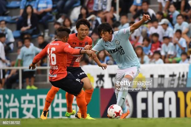Shunsuke Nakamura of Jubilo Iwata takes on Mateus of Omiya Ardija during the JLeague J1 match between Jubilo Iwata and Omiya Ardija at Yamaha stadium...