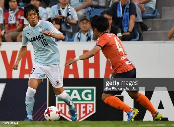 Shunsuke Nakamura of Jubilo Iwata takes on Yuzo Iwakami of Omiya Ardija during the JLeague J1 match between Jubilo Iwata and Omiya Ardija at Yamaha...