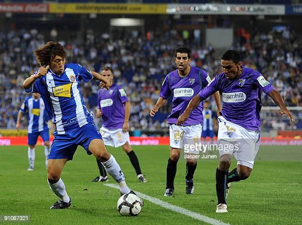Shunsuke Nakamura of RCD Espanyol duels for the ball with Patrick Mtiliga and Juan Gutierrez during the La Liga match between Espanyol and Malaga at...