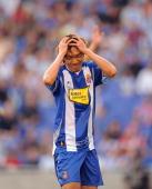Shunsuke Nakamura of RCD Espanyol reacts after his shot went wide of target during the La Liga match between Espanyol and Xerez CD at Estadi Olimpic...