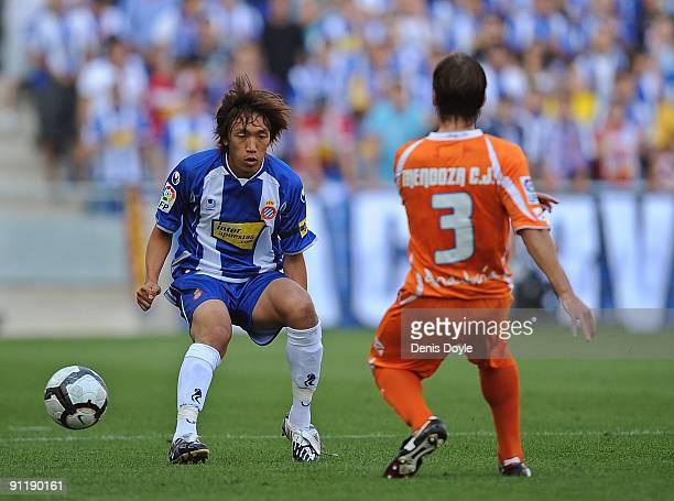 Shunsuke Nakamura of RCD Espanyol tackles Jesus Mendoza of Jerez during the La Liga match between Espanyol and Xerez CD at Estadi Olimpic Lluis...