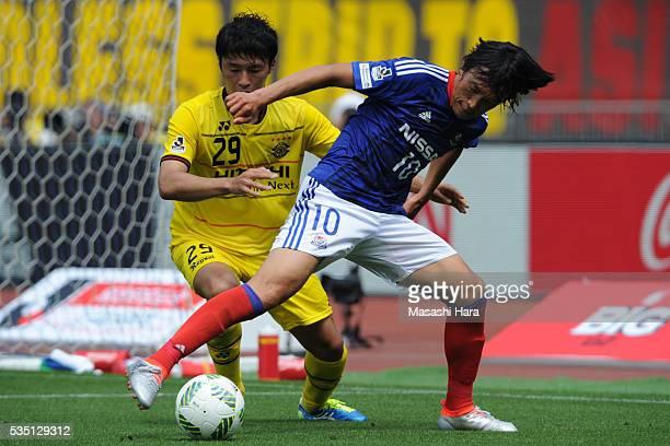 Shunsuke Nakamura of Yokohama FMarinos and Yuta Nakayama of Kashiwa Reysol compete for the ball during the JLeague match between Yokohama FMarinos...