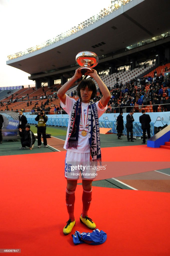 Shunsuke Nakamura of Yokohama F.Marinos poses with the Emperor's Cup after the 93rd Emperor's Cup final between Yokohama F.Marinos and Sanfrecce Hiroshima at the National Stadium on January 1, 2014 in Tokyo, Japan.