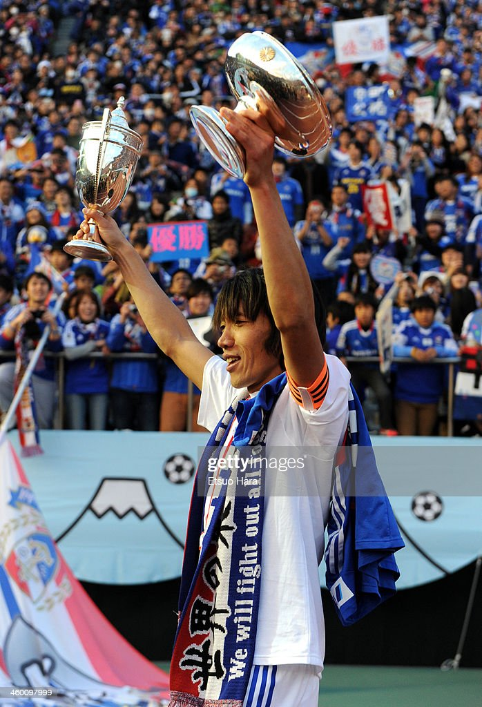 Shunsuke Nakamura of Yokohama F.Marinos poses with the Emperor's Cup after the 93rd Emperor's Cup final between Yokohama F.Marinos and Sanfrecce Hiroshima at the National Stadium on January 1, 2014 in Tokyo, Japan.