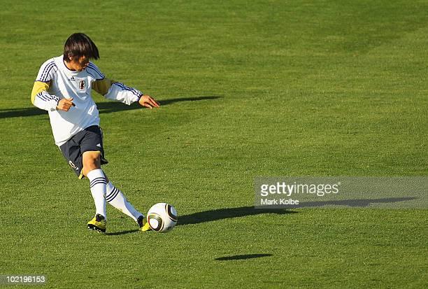 Shunsuke Nakamura passes at a Japan training session during the FIFA 2010 World Cup at Princess Magogo stadium on June 18 2010 in Durban South Africa