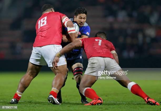 Shunsuke Nunomaki of Japan tackled by Paea FaÕanunu and Tukulua Lokotui of Tonga during the international match between Japan and Tonga at Stade...