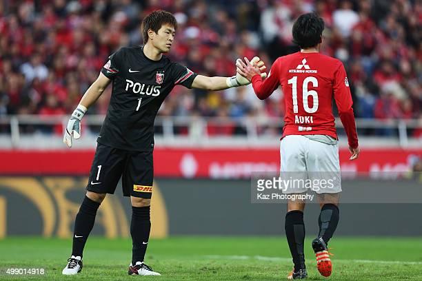 Shusaku Nishikawa and Takuya Aoki of Urawa Red Diamonds high five during the JLeague 2015 Championship semi final match between Urawa Red Diamonds...