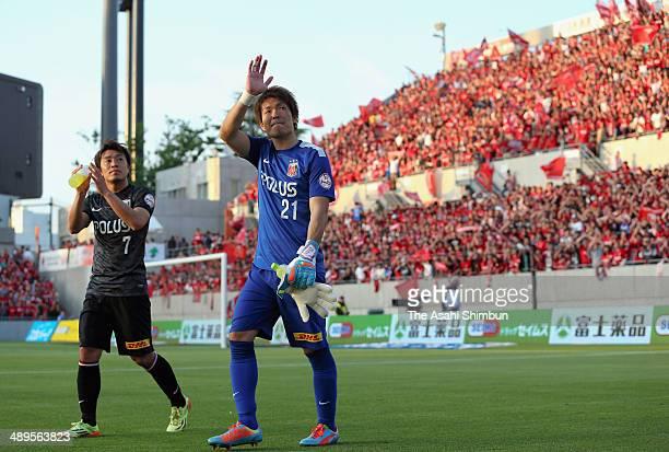 Shusaku Nishikawa and Tsukasa Umesaki of Urawa Red Diamonds celebrate the win after the JLeague match between Omiya Ardija and Urawa Red Diamonds at...