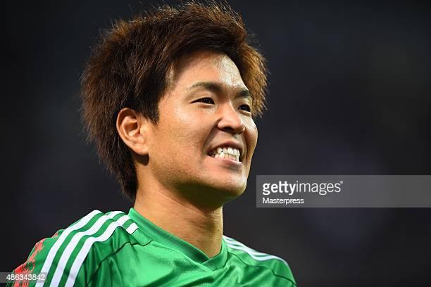 Shusaku Nishikawa of Japan smiles during the 2018 FIFA World Cup Qualifier Round 2 Group E match between Japan and Cambodia at Saitama Stadium on...
