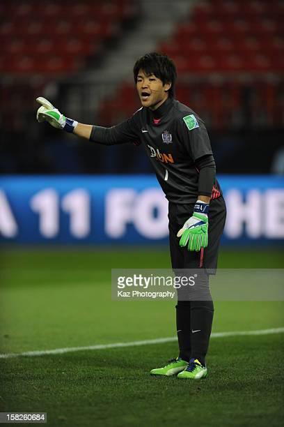 Shusaku Nishikawa of Sanfrecce Hiroshima gives advice to his teammates during the FIFA Club World Cup fifthplace match between Ulsan Hyundai and...