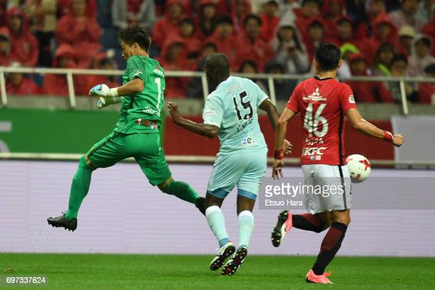 Shusaku Nishikawa of Urawa Red Diamonds and Adailton of Jubilo Iwata compete for the ball during the JLeague J1 match between Urawa Red Diamonds and...