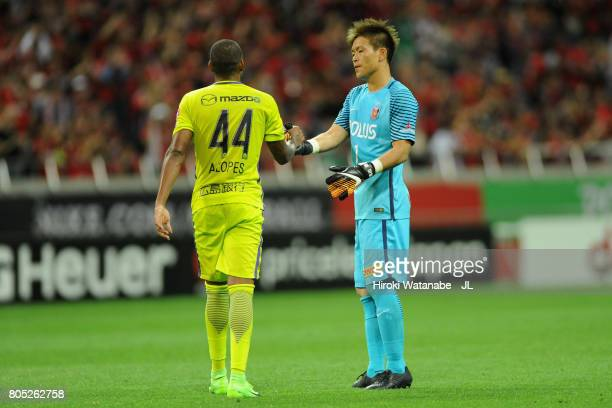 Shusaku Nishikawa of Urawa Red Diamonds and Anderson Lopes of Sanfrecce Hiroshima shake hands after the JLeague J1 match between Urawa Red Diamonds...