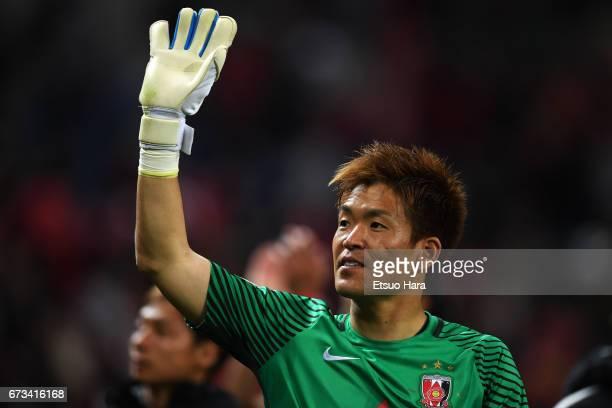 Shusaku Nishikawa of Urawa Red Diamonds applauds fans after the AFC Champions League Group F match between Urawa Red Diamonds and Western Sydney at...