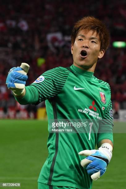 Shusaku Nishikawa of Urawa Red Diamonds celebrates the win after the AFC Champions League Group F match between Urawa Red Diamonds and Shanghai SIPG...