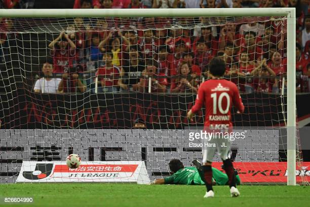 Shusaku Nishikawa of Urawa Red Diamonds dives in vain as Yusuke Segawa of Omiya Ardija scores his side's second goal during the JLeague J1 match...