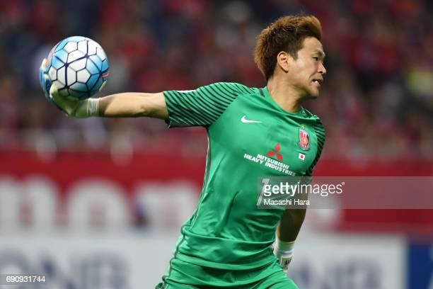 Shusaku Nishikawa of Urawa Red Diamonds in action during the AFC Champions League Round of 16 match between Urawa Red Diamonds and Jeju United FC at...
