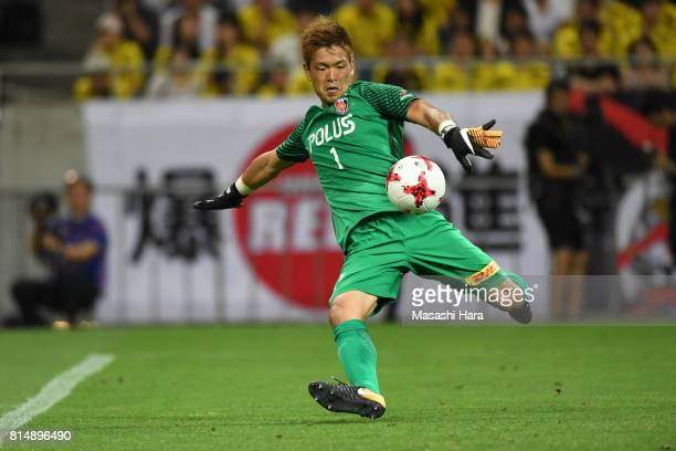Shusaku Nishikawa of Urawa Red Diamonds in action during the preseason friendly match between Urawa Red Diamonds and Borussia Dortmund at Saitama...