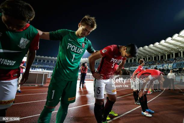 Shusaku Nishikawa Tomoaki Makino and Urawa Red Diamonds bow toward supporters after their 14 defeat in the JLeague J1 match between Kawasaki Frontale...