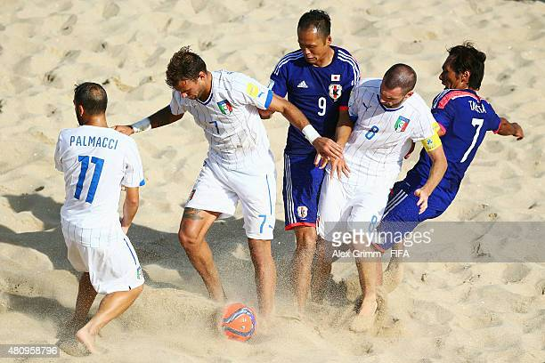 Shusei Yamauchi and Teruki Tabata of Japan are challenged by Paolo Palmacci Dario Ramacciotti and Francesco Corosiniti of Italy during the FIFA Beach...