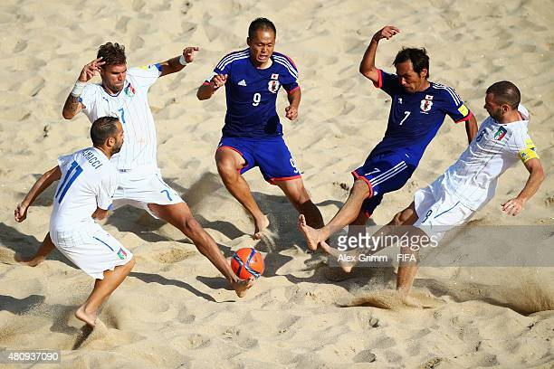 Shusei Yamauchi and Teruki Tabata of Japan is challenged by Paolo Palmacci Dario Ramacciotti and Francesco Corosiniti of Italy during the FIFA Beach...