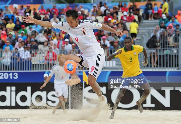 Shusei Yamauchi of Japan controls the ball during the FIFA Beach Soccer World Cup Tahiti 2013 Quarter Final match between Brazil and Japan at the...