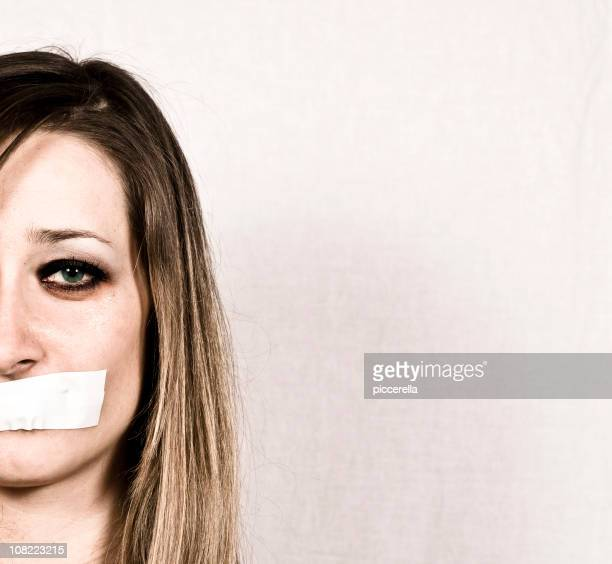Shut up concept of woman with tapes mouth
