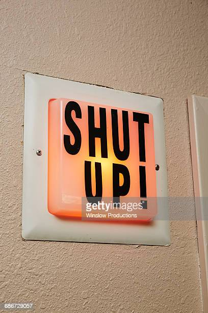 Shut up sign in radio station