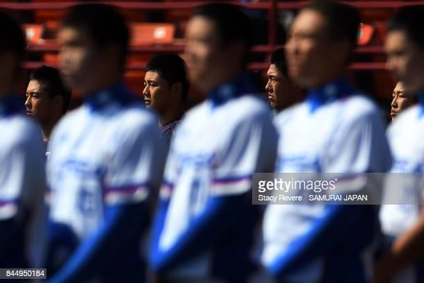 Shuto Sakurai Kotaro Kiyomiya Hisanori Yasudan and Kaito Kozono of Japan stand for the Japanese National Anthem prior to a game against Korea during...