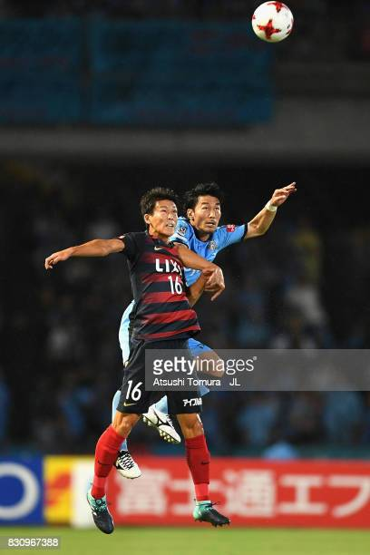 Shuto Yamamoto of Kashima Antlers and Akihiro Ienaga of Kawasaki Frontale compete for the ball during the JLeague J1 match between Kawasaki Frontale...