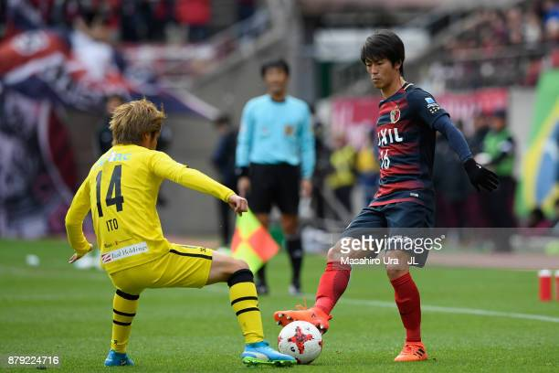 Shuto Yamamoto of Kashima Antlers and Junya Ito of Kashiwa Reysol compete for the ball during the JLeague J1 match between Kashima Antlers and...