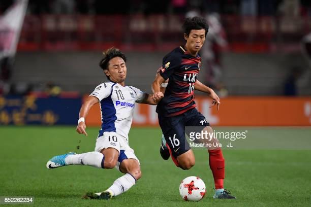 Shuto Yamamoto of Kashima Antlers and Shu Kurata of Gamba Osaka compete for the ball during the JLeague J1 match between Kashima Antlers and Gamba...
