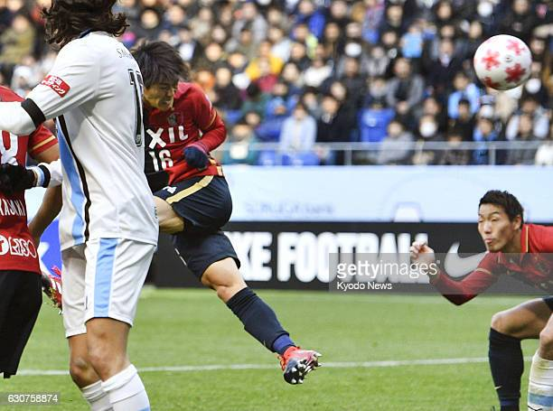 Shuto Yamamoto of Kashima Antlers heads his team into a 42ndminute lead against Kawasaki Frontale in the Emperor's Cup final at Suita Stadium in...