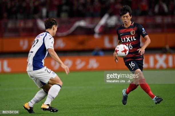 Shuto Yamamoto of Kashima Antlers takes on Oh Jae Suk of Gamba Osaka during the JLeague J1 match between Kashima Antlers and Gamba Osaka at Kashima...