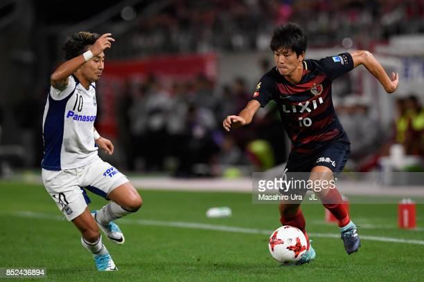 Shuto Yamamoto of Kashima Antlers takes on Shu Kurata of Gamba Osaka during the JLeague J1 match between Kashima Antlers and Gamba Osaka at Kashima...
