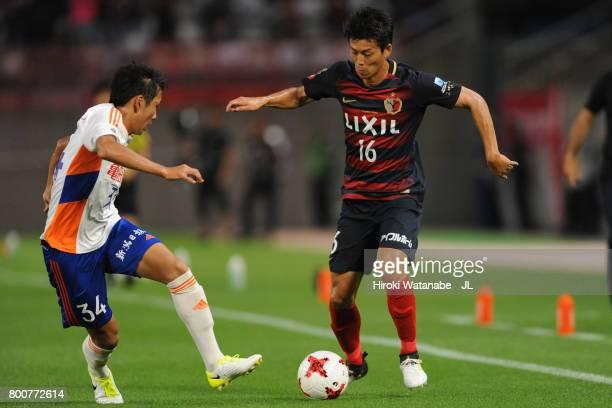 Shuto Yamamoto of Kashima Antlers takes on Teruki Hara of Albirex Niigata during the JLeague J1 match between Kashima Antlers and Albirex Niigata at...
