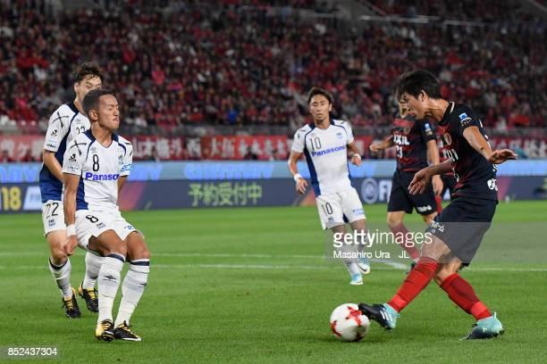 Shuto Yamamoto of Kashima Antlers takes on Yosuke Ideguchi of Gamba Osaka during the JLeague J1 match between Kashima Antlers and Gamba Osaka at...