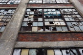 A shuttered factory sits empty with broken windows on September 18 2011 in Bridgeport Connecticut Despite some of the poorest cities in the country...