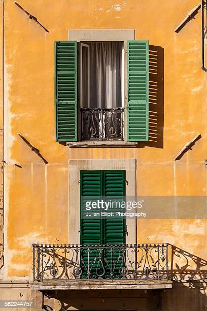 Shuttered windows on Piazza Grande in Arezzo.