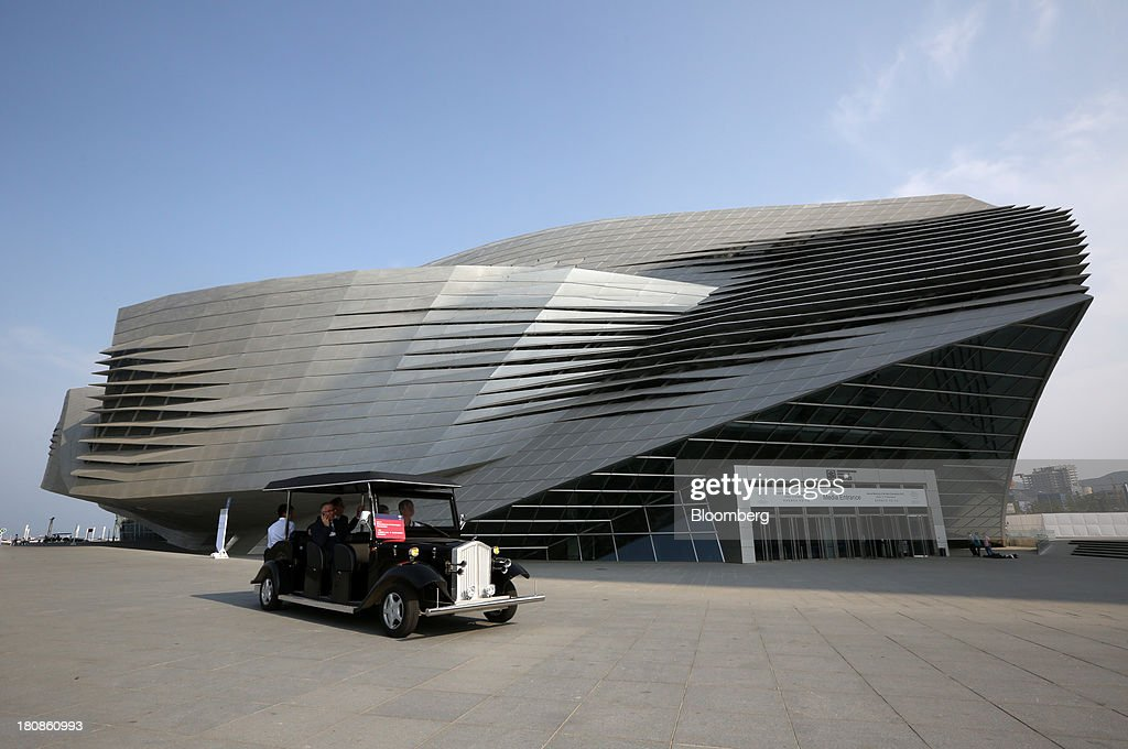 A shuttle vehicle drives past the Dalian International Conference Center at the Dalian Wanda Center in Dalian, China, on Friday, Sept. 13, 2013. Goldman Sachs Group Inc. this month raised its estimate for China's economic growth for the third and fourth quarters, citing improving global demand and a stronger-than-expected domestic industrial recovery. Photographer: Tomohiro Ohsumi/Bloomberg via Getty Images