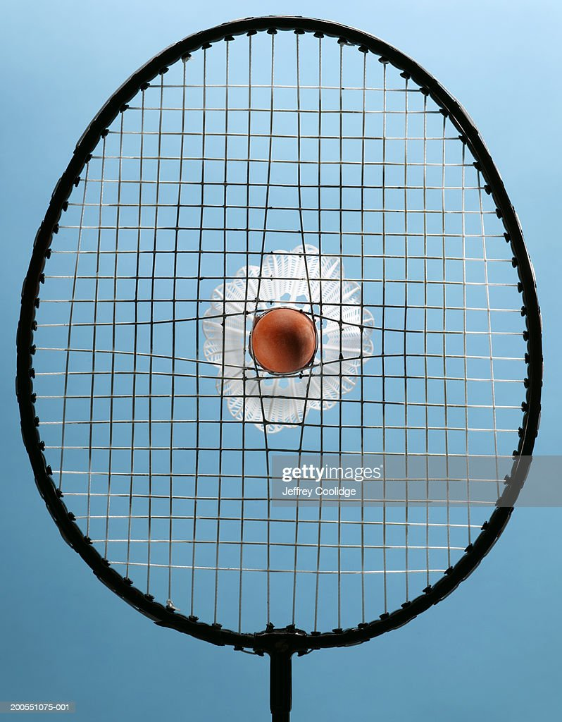 Shuttlecock stuck in badminton racket