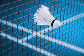 shuttlecocks struck on the net in badminton court for sport background